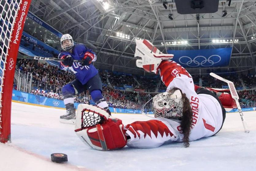 Jocelyne Lamoureux-Davidson beats Canada goalie Shannon Szabados during the shootout.