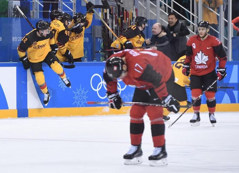 Rene Bourque (17) and his Canadian teammates are dejected as Germany celebrates an unlikely trip to the gold-medal game.