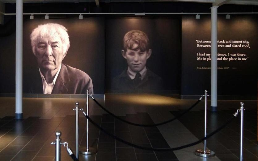 Portraits of the adult poet and the young boy dominate the lobby of the Seamus Heaney HomePlace.
