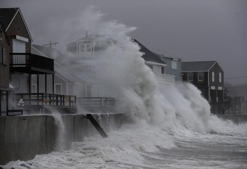 Waves crashed onto a house along Turner Road in Scituate.