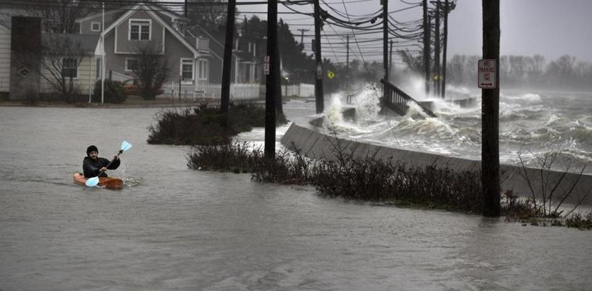 Daniel Cunningham dodged waves on E. Squantum Street in Qunicy.