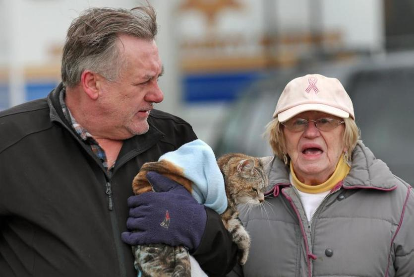 "QUINCY, MA - 3/03/2018: ""Mittens"" is bunndled and carried by Mitchell Wojtasinski ,son n law to Mary Johnson, they had to leave their storm damaged home in Quincy (David L Ryan/Globe Staff ) SECTION: METRO TOPIC 04storm"