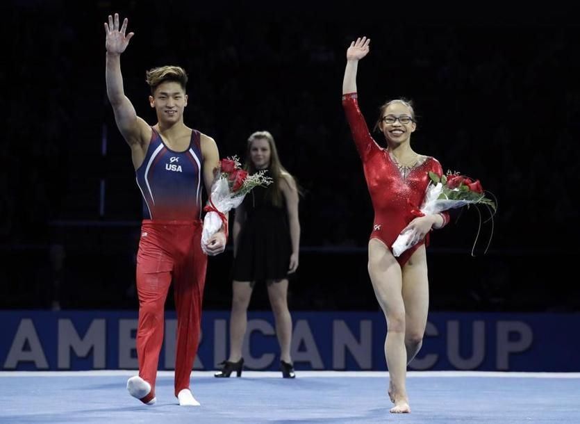 Yul Moldauer (left) and Morgan Hurd acknowledge the crowd after winning all-around golds medals at the American Cup.