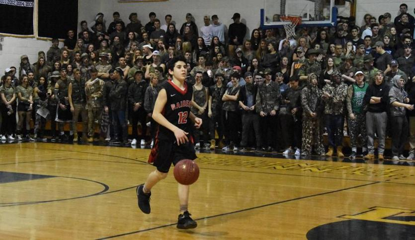 Watertown freshman Gabe Spinelli seemed to be alone in hostile territory Saturday night. Spinelli and the seventh-seeded Raiders came out of Lynnfield with a 62-44 victory in a MIAA Division 3 North quarterfinal.