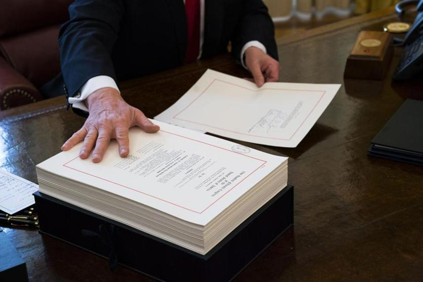 President Donald Trump signed the tax reform bill in the Oval Office.