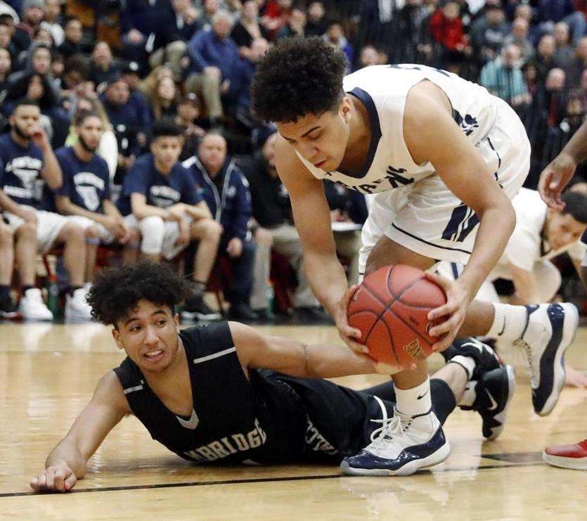 Cambridge's Adrian Williams battles Lawrence's Luis Reynoso, right, for a loose ball during their D1 North semifinal game in North Andover, Mass., Tuesday, March 6, 2018. (Winslow Townson for The Boston Globe)