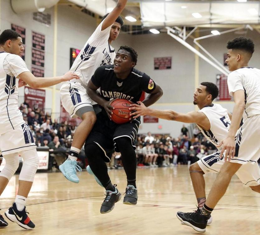Cambridge's Solomon Hearn tries to get through four Lawrence defenders including Juan Felix Rodriguez (5) and Sebastian Dilone, top, during their D1 North semifinal game in North Andover, Mass., Tuesday, March 6, 2018. (Winslow Townson for The Boston Globe)