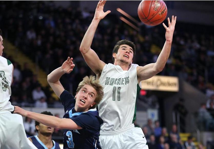 Mansfield's Ryan Otto grabs a rebound over Franklin's Christopher Edgehill. (JOHN TLUMACKI/THE BOSTON GLOBE)
