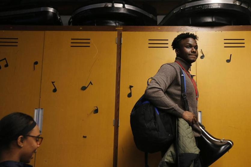 Brockton, MA -- 4/03/2018 - John Hyppolite, a Junior, who plays with the Brockton High School Advanced Concert Band packs up his things after practice. (Jessica Rinaldi/Globe Staff) Topic: 04brocktonband Reporter: