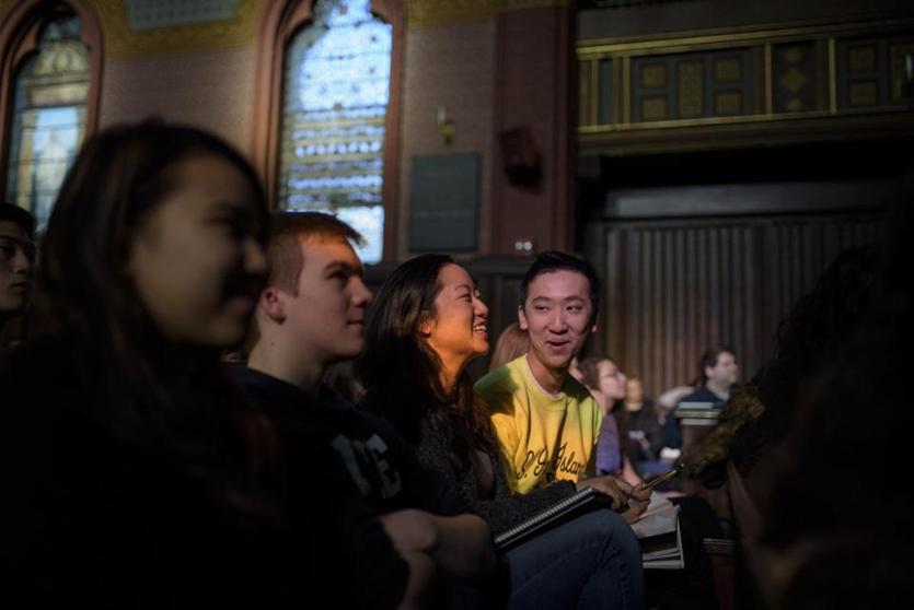 "Jennifer Chen, left, and Sean Guo laugh during their ""Psychology and the Good Life"" class in Battell Chapel at Yale University in New Haven, Conn., Jan. 25, 2018. The course, with nearly 1,200 students signed up, tries to teach them how to lead a happier, more satisfying life in twice-weekly lectures. (Monica Jorge/The New York Times)"