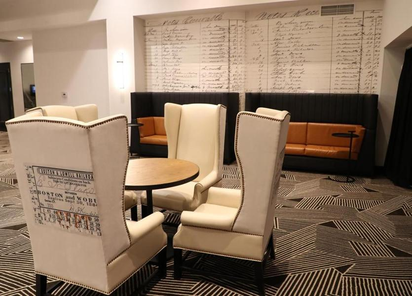 The leather chairs with Boston to Woburn train tickets outside Thompson Hall (large meeting room) in the Woburn Hilton.