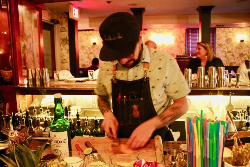 Bartender Derek McCusker prepares a cocktail at the Baldwin Bar in Woburn.