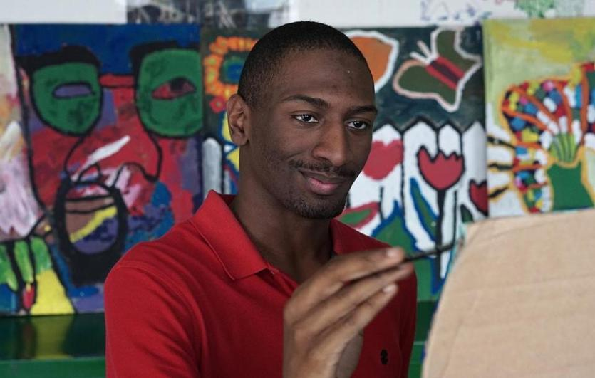 "05DisabilityDoc -- Naieer in art class in Dan Habib's movie, ""Intelligent Lives"".(intelligentlives.org)"