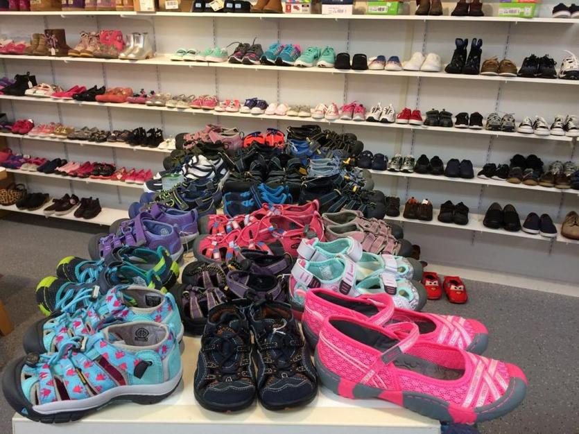 Trendy Tots has a huge collection of children's shoes, including water shoes and rain boots.