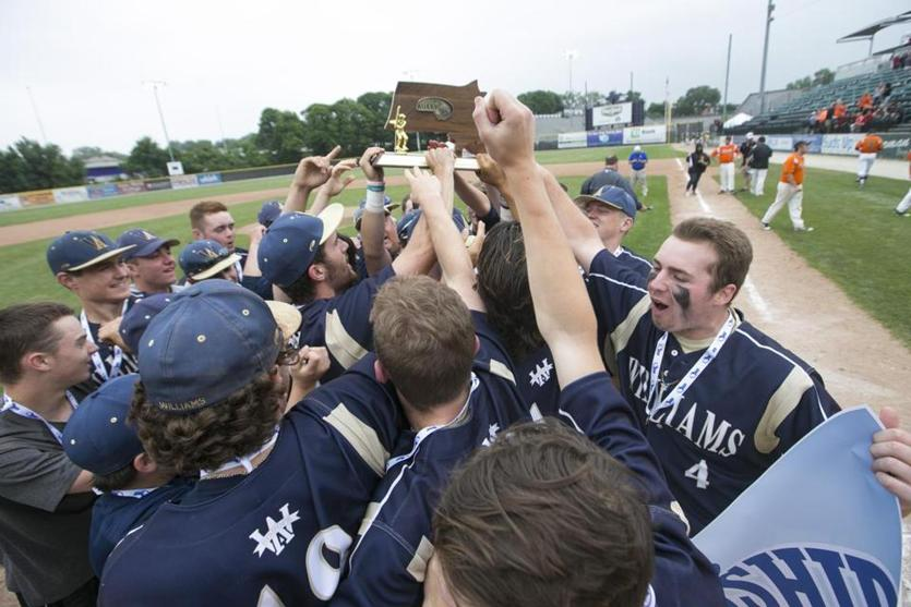 Archbishop Williams players hoist the MIAA Division 4 baseball championship trophy at Holy Cross after defeating  Oxford, 4-3, in nine innings Saturday afternoon.