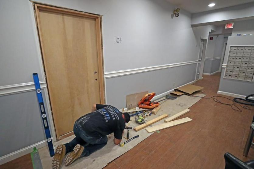 Installing the door is Ken Stuart with New England Sound Proofing.