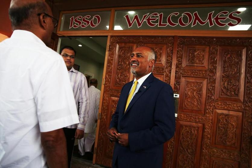 LOWELL, MA - 08/18/2018 Beej Das, right, talks to voters at the ISSO Shree Swaminarayan Temple. Das is one of 10 democratic candidates running for Congress in Massachusetts' Third Congressional District. Erin Clark for The Boston Globe