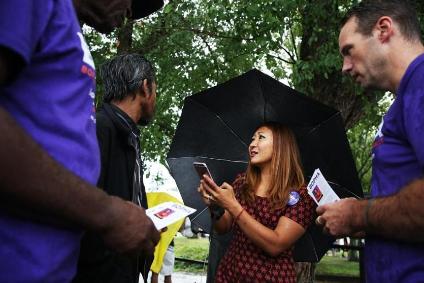 LOWELL, MA - 08/18/2018 Bopha Malone greets voters at the Lowell Southeast Asian Water Festival. Malone is one of 10 democratic candidates running to represent the people of Massachusetts' 3rd District in U.S. Congress. Erin Clark for The Boston Globe