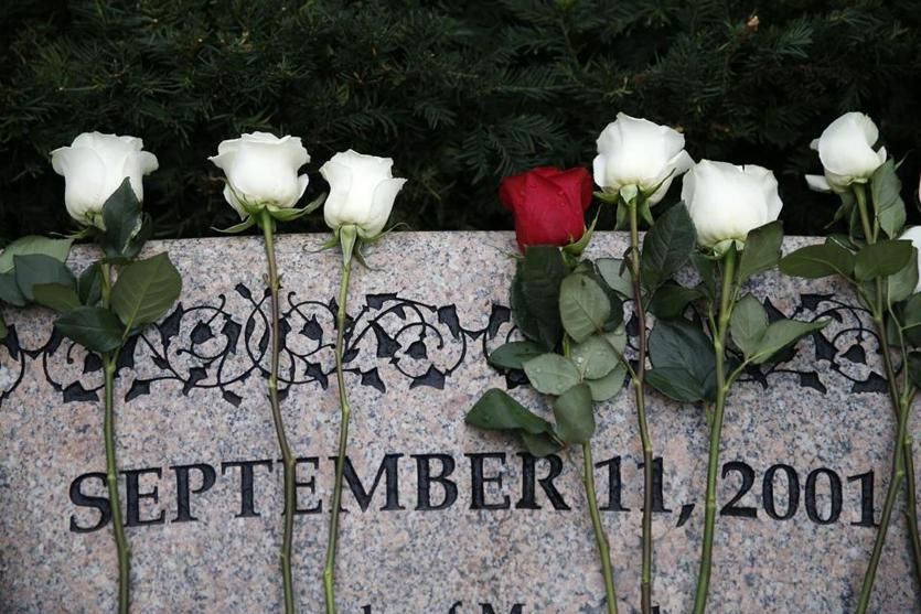 Boston, MA--9/11/2018-- Roses rest against a memorial wall following a 9/11 wreath laying ceremony at Boston Public Garden. (Jessica Rinaldi/Globe Staff) Topic: 12nineeleven Reporter: