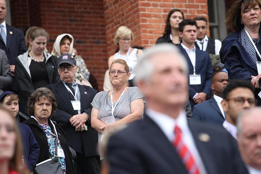 Boston, MA., 09/11/18, Seventeen years after the events of 9/11, remembrances and ceremonies are held at the Massachusetts State House. The faces were solemn on the steps of the state house during the Flag Lowering, Moment of Silence, and Reading of Names. Suzanne Kreiter/Globe staff
