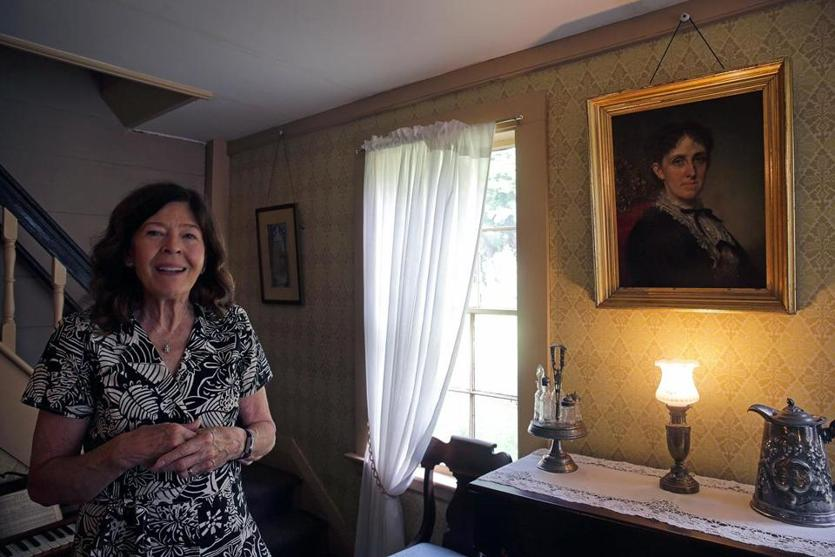 Concord, MA - 9/11/2018 - Jan Turnquist, Executive Director, Louisa May AlcottÕs Orchard House in Concord, MA next to a portrait of Louisa May Alcott done by George Healy, a famous portrait painter. - (Barry Chin/Globe Staff), Section: West Regional, Reporter: Nancy West, Topic: 23wealcott, LOID:8.4.3124863628.