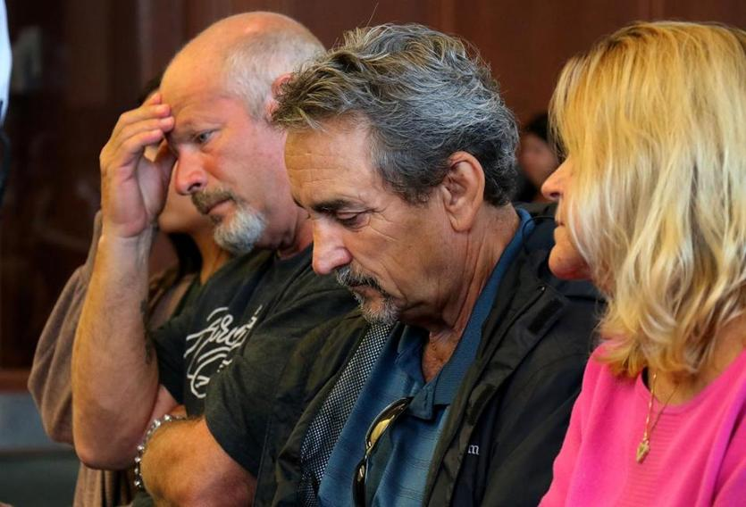 The family of Shana Warner, including her boyfriend, John Tallent (left); her father, Tom DeFilippo; and his wife, Maureen, listened to the charges in Plymouth District Court on Wednesday.