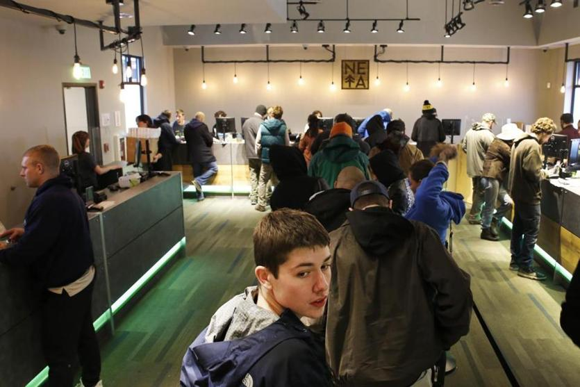 Northampton, MA - 11/20/2018- ] Steve Jones, 21, of Simsbury, CT, looks back at people coming in while waiting in line at NETA on Tuesday, November 20, 2018. (Michael Swensen for The Boston Globe) Topic: (metro)