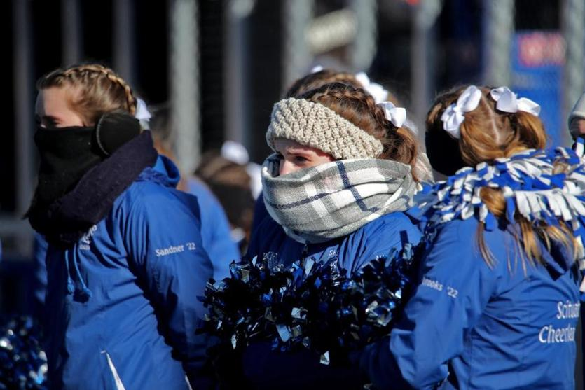 Hingham MA 11/22/18 Scituate High cheerleaders bundled up on the sidelines against Hingham High during first quarter action at Hingham High School. (photo by Matthew J. Lee/Globe staff) topic: 23schbraintree reporter: