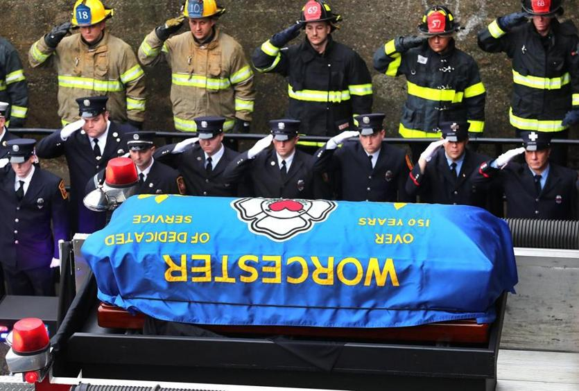 Worcester firefighter Christopher Roy's casket was carried atop the fire truck he was assigned to, during Saturday's funeral procession.