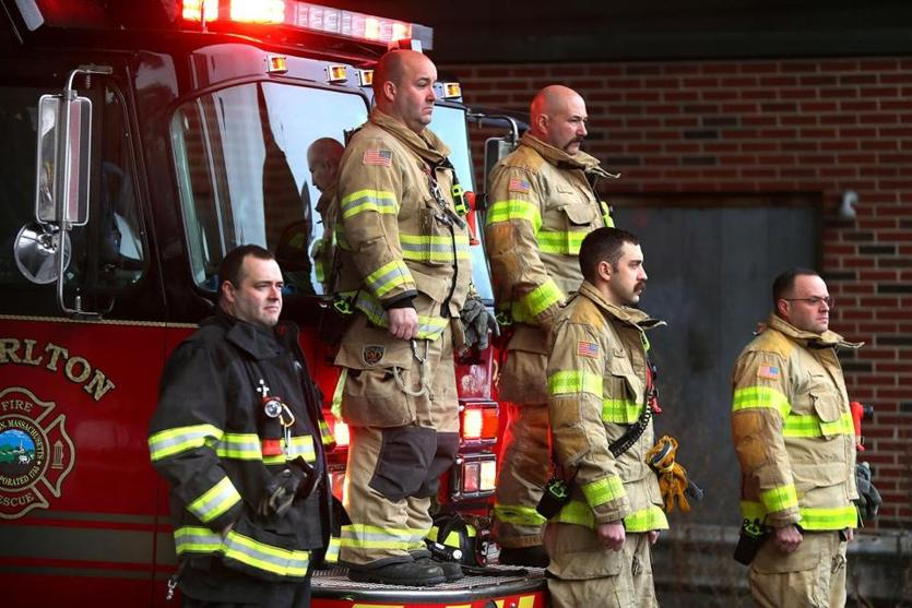 Charlton firefighters stood during the funeral procession.