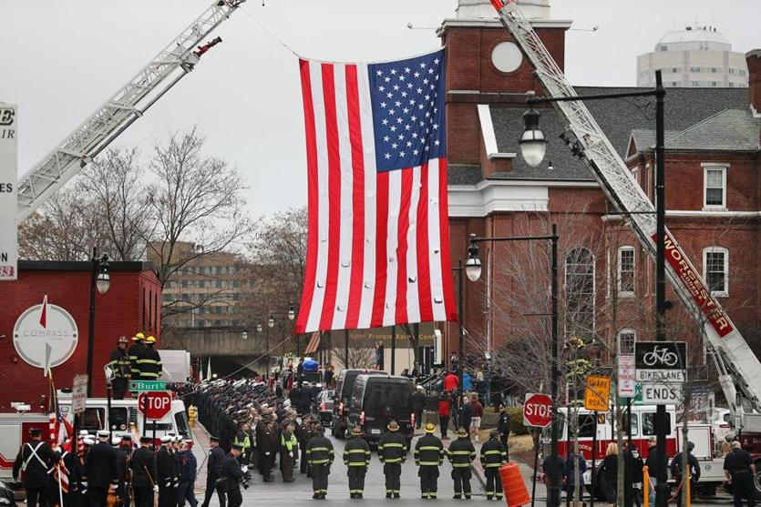 A huge American flag was displayed near St. John's Catholic Church.