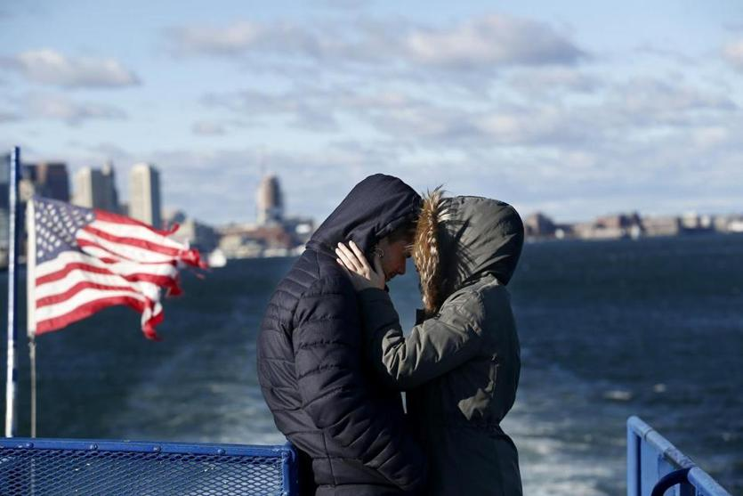 Boston, MA, 01/1/2019 -- Eva Ritzenhoff, of Germany (R) snuggled with Andre Mendes, of Cambridge as they took a ferry to Thompson Island. For 35 years the Friends of the Boston Harbor Islands have been running a New Year's Day excursion to Thompson Island. (Jessica Rinaldi/Globe Staff) Topic: 02islandtrip Reporter: