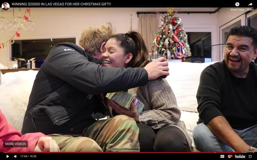 Jason Nash gets a hug from his nanny after giving her all of his $20,000 Vegas winnings to express their gratitude for her services. Image taken from YouTube.