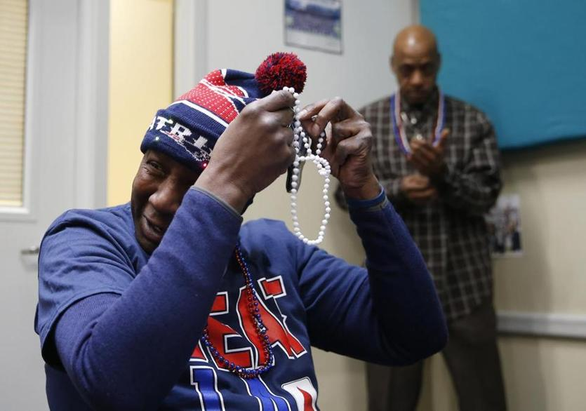 "Boston, MA, 02/3/2019 -- ""Blu"" put on beads in Patriots colors during a tailgate party at St. Francis House ahead of the Super Bowl. (Jessica Rinaldi/Globe Staff) Topic: 04stfrancisparty Reporter:"