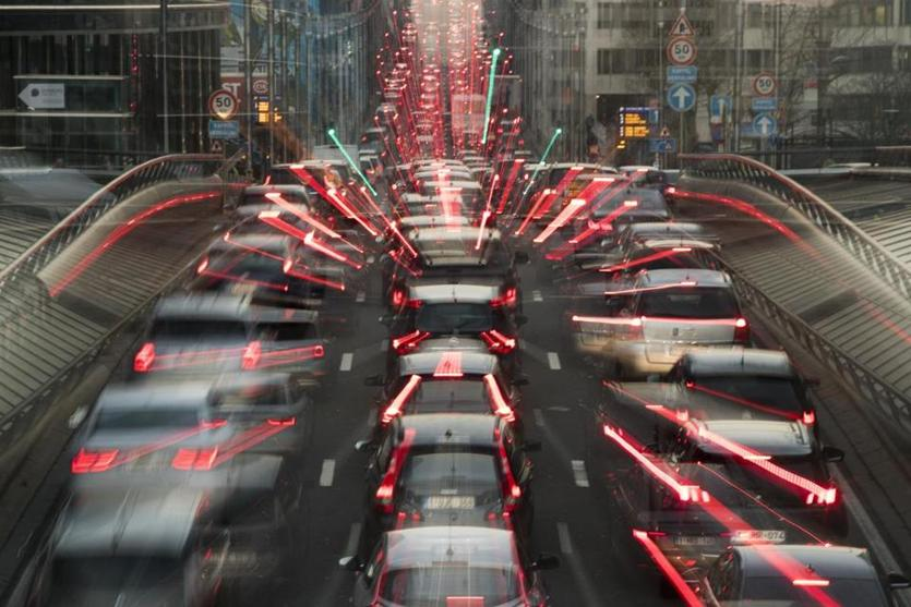 In this slow-shutter zoom effect photo, commuters backed up in traffic during the morning rush hour Wednesday, Dec. 12, 2018, in Brussels, a city that regularly experiences pollution alert warnings. Predictions from international climate expert, warn that global warming is set to do irreversible environmental damage, with pollutants from burning fossil fuels as one of the main contributors to climate changes. (AP Photo/Francisco Seco)