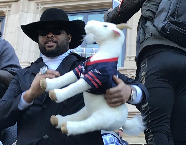 Patriots players passed around a stuffed goat tossed to them by Michael Brody and his wife, Sheri. (Michael Brody)