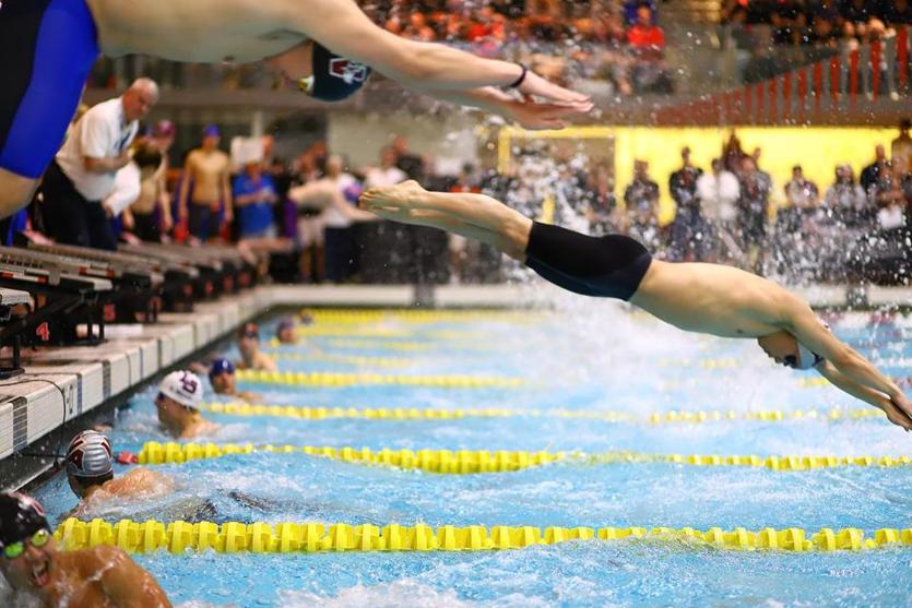 Swimmers compete at the MIAA North boys' swimming and diving championships at MIT's Zesiger Center pool.