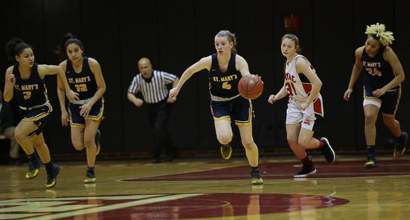 Olivia Matela pushes the ball up court for St. Mary's in Saturday's Division 3 state final at WPI.