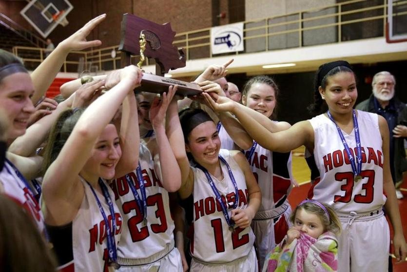 Hoosac players celebrated their 66-50 win over St. Mary's and the program's first state title at WPI Saturday.