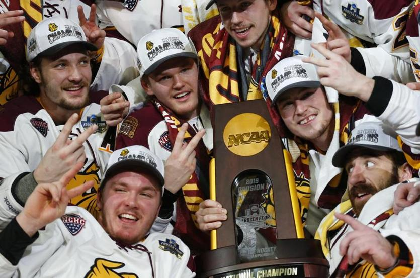 Minnesota Duluth players celebrate a 3-0 victory over UMass for the title.