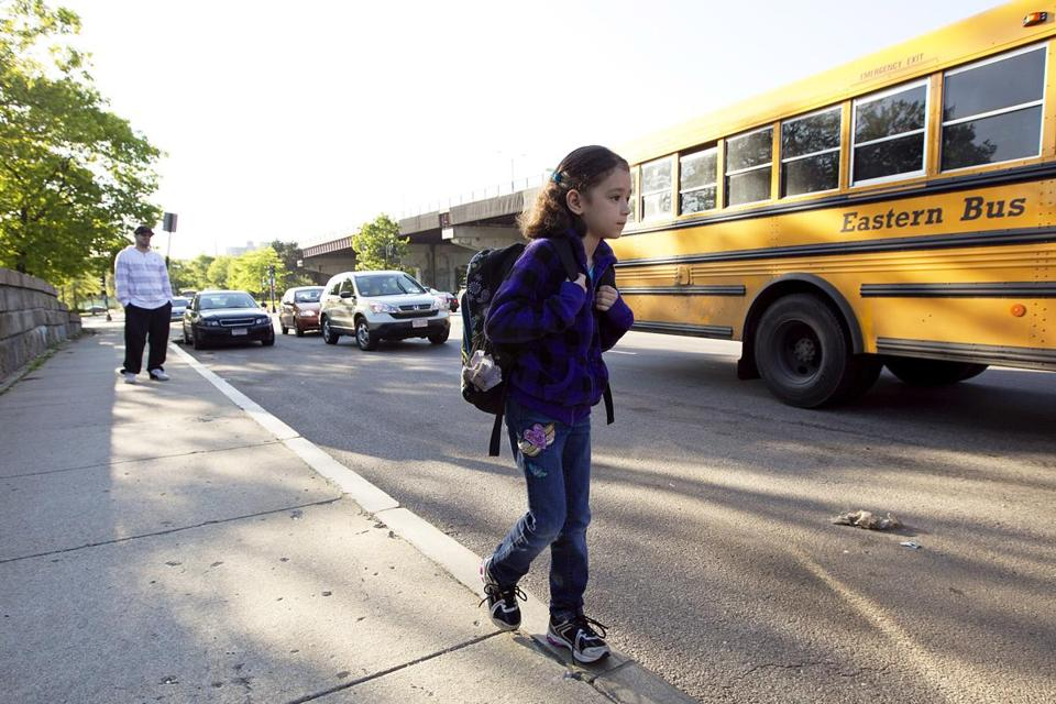 With her father, Alex, watching, Aryana Saavedra headed to a bus that takes her to school in Wellesley.