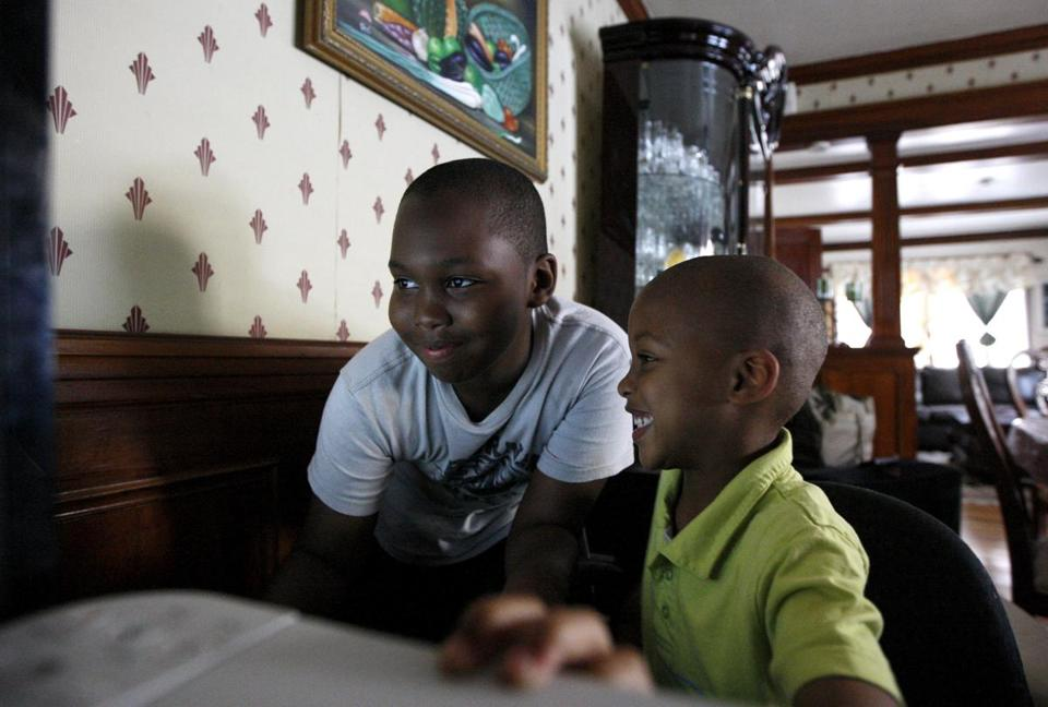 Betty Legendre is struggling with the school assignment of her son Jeffrey (right), 5.
