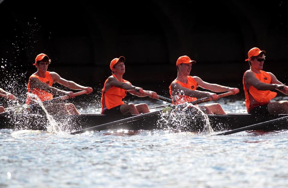 Brown University shows its winning form in the club eights, capturing the race less than a second ahead of Princeton.