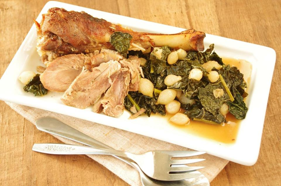 Braised turkey drumsticks with beer, kale, and pearl onions