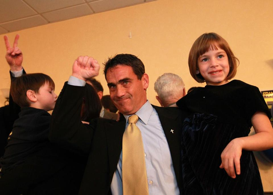 Frank Baker celebrated with his twin children, Benjamin (left) and Maxine at his post election party.