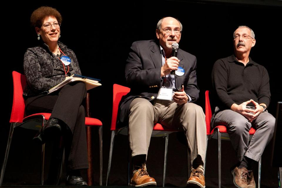 Northeastern professor Barry Bluestone answered an audience question yesterday flanked by panelists Liz Cohen and Thomas Shapiro during a teach-in, which he organized with help from former governor and fellow professor Michael Dukakis.