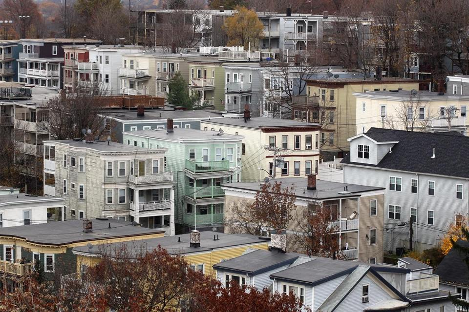 Triple-deckers can be seen from the belfry of First Parish Church in Dorchester in this 2011 file photo.