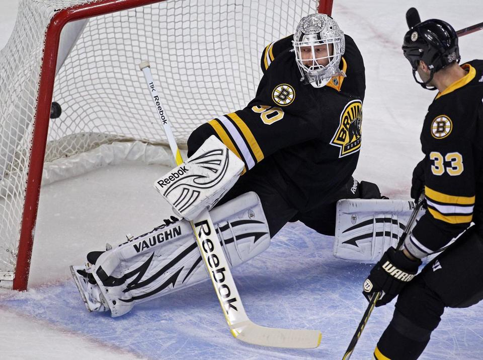 12-19-11: Boston, MA: Bruins goalie Tim Thomas gets a ggod look as the first period goal by Montreal's Tomas Piekanec (not pictured) gets by him. Zdeno Chara is at right. The Boston Bruins hosted the Montreal Canadiens in a regular season NHL game at the TD Garden. (Globe Staff Photo/Jim Davis) section:sports topic:Bruins