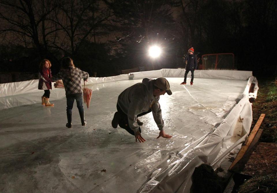 Jon Frankel of Brookline (center) checked the condition of his backyard  skating rink as - Backyard Skating Enthusiasts Bemoan Warm Winter - The Boston Globe