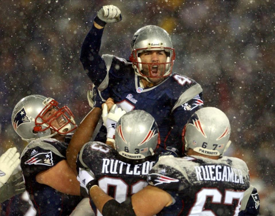 Adam Vinatieri had a snowy celebration after kicking the winning field goal for the Patriots in overtime.